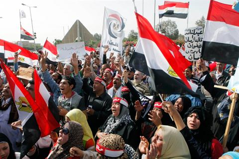 Supporters of Egypt's military shout anti-Muslim Brotherhood slogans and wave national flags during a protest in front of the Unknown Soldier memorial, in Cairo, Egypt, Friday, March 15, 2013.