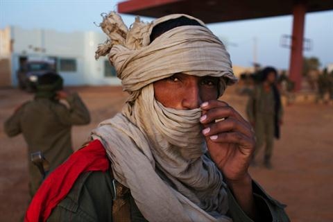 An ethnic Tuareg Malian soldier under the command of Col. El Hadj Ag Gamou fixes his headscarf at a checkpoint in Gao in this March 3, 2013 file photo.